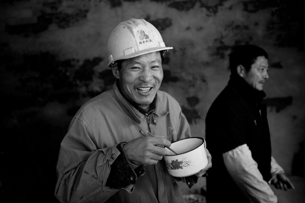 Beijing, Migrant workers having lunch